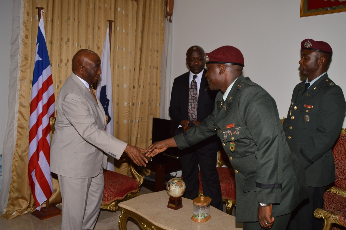 Vice President Boakai Shakes Hands with Lt. Col. Forleh